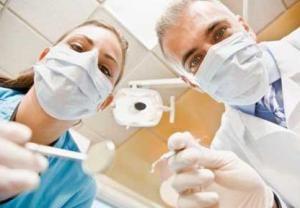 Dantų gydymo galimybės per NHS: pigiau arba išvis nemokamai
