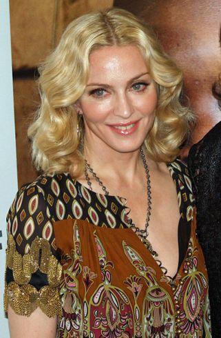 Madonna tariasi su McCartney skyrybų advokate