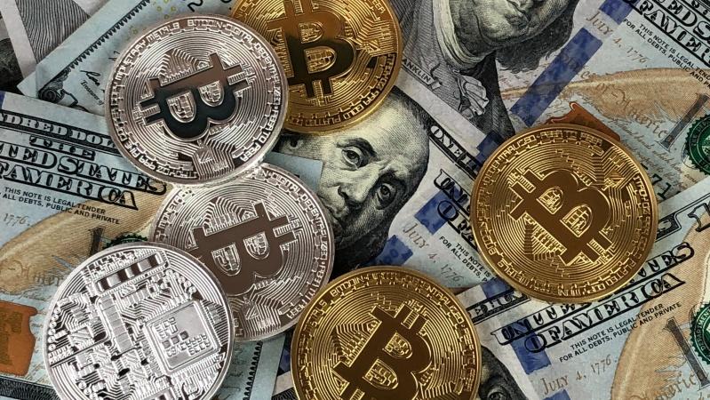 JK uždraustas kripto valiutos keitimas